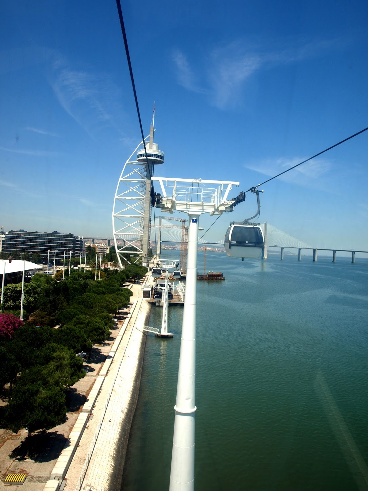 Lisbon, Lisboa, portugal, views, vasco da gama, vasco da gama bridge, vasco da gama tower, cable car, statue of christ, christ the king, travel, travel blog, top 10 lisbon, to do in lisbon, things to do, scrapbook, travel blog, travel tips, the roaming renegades, paul short, nicola hilditch-short, chriso Rei, almada, 25th April bridge, 25 de Abril Bridge, Estradio da Luz, Stadium of Light, Benfica, Santa Justa Elevator, St George's castle, Sao Jorge castle, Miradouros, São Pedro de Alcantara: Elevador da Glória or walk up from Chiado. Portas do Sol: Walk up from Baixa or tram 28. Miradouro da Graça: Walk up from Alfama or tram 28. Miradouro de Santa Luzia:, Alfama, Arco da Rua Augusta, Baixa, Cascais