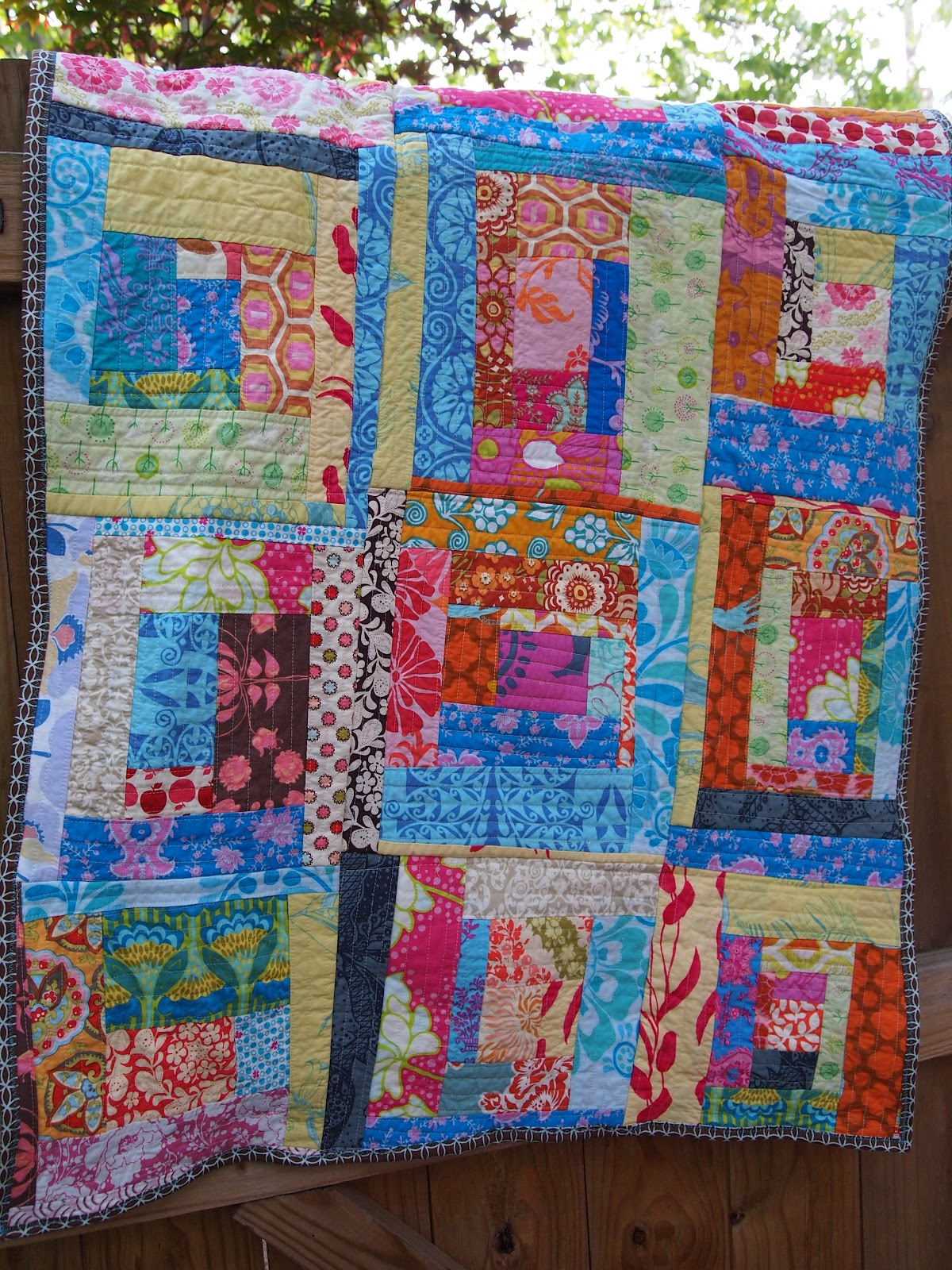 Plum and june log cabin baby quilt