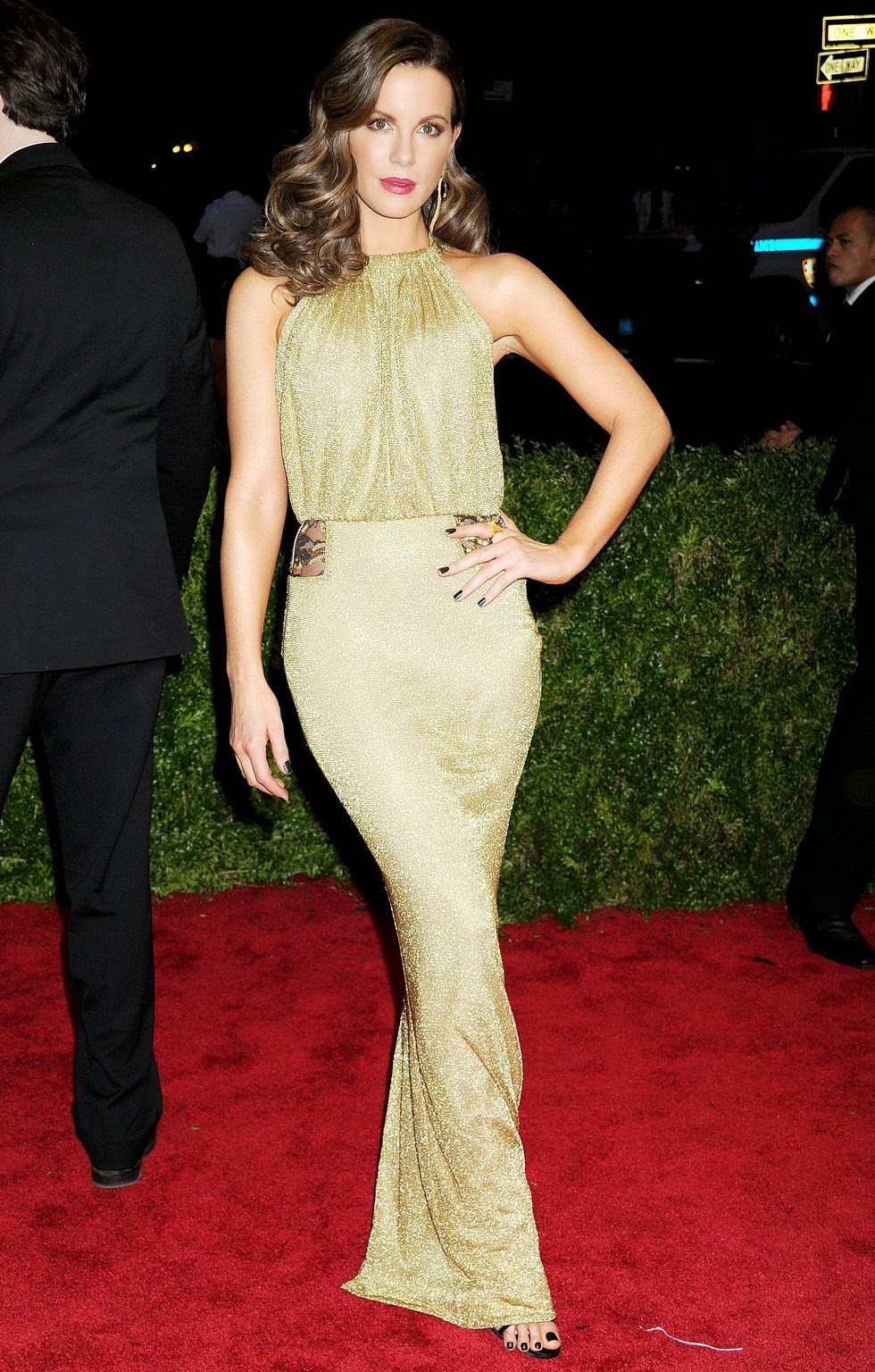 Kate Beckinsale shimmers in a slinky gold gown at the 2015 Met Gala in NYC