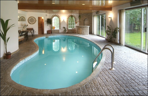 Home arcitect indoor swimming pool design for Indoor pool design uk