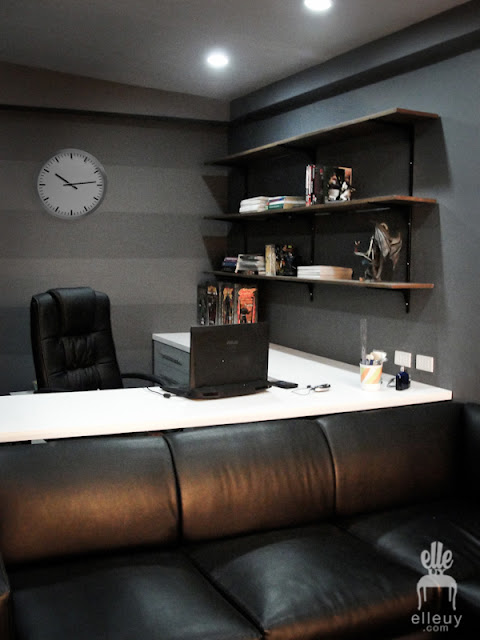 dark walls, black walls, home office, stripe wall, display shelves, black room