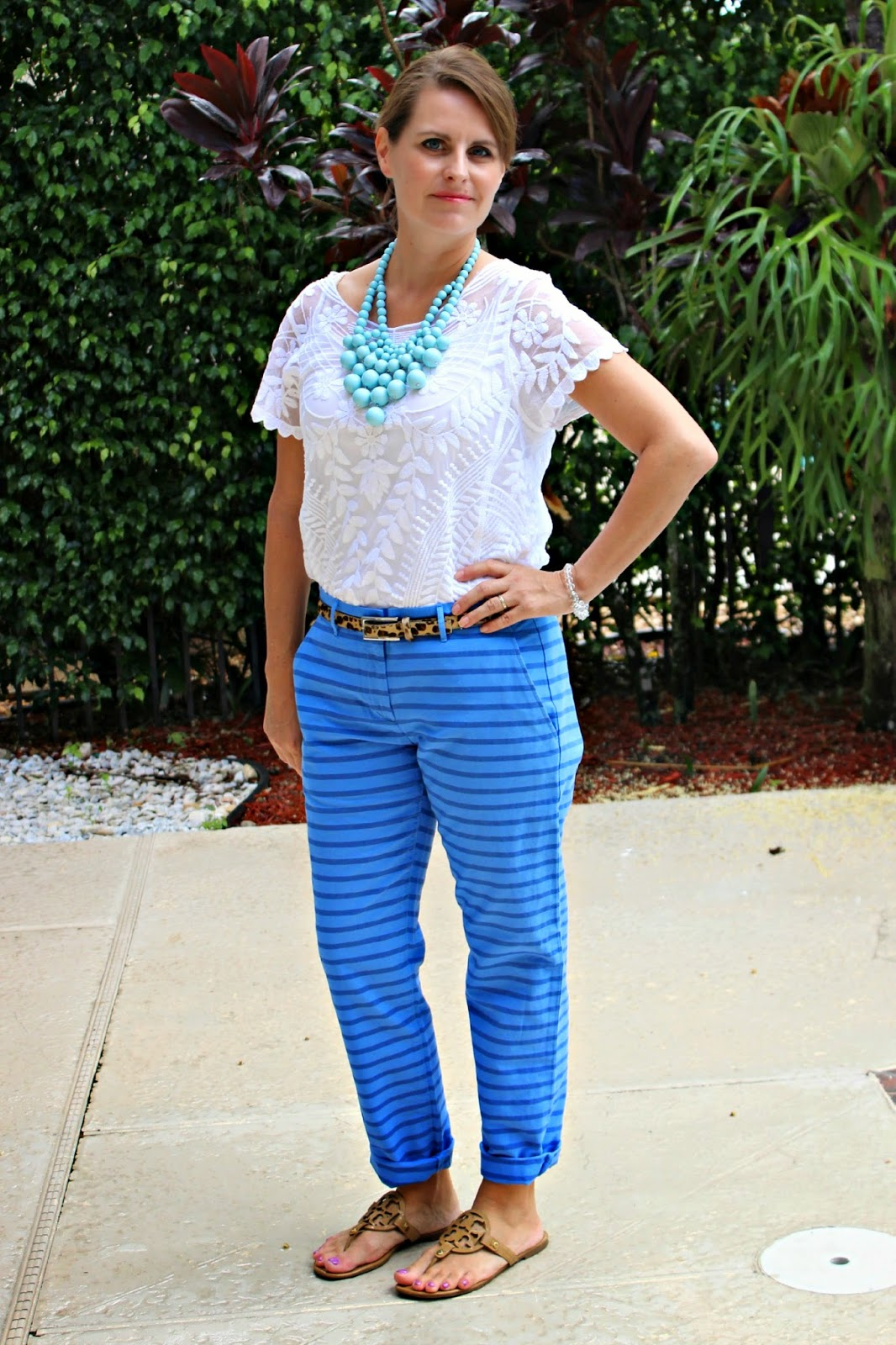 Express baroque lace top, gap striped boyfriend pants, leopard belt. mint blue bubble necklace