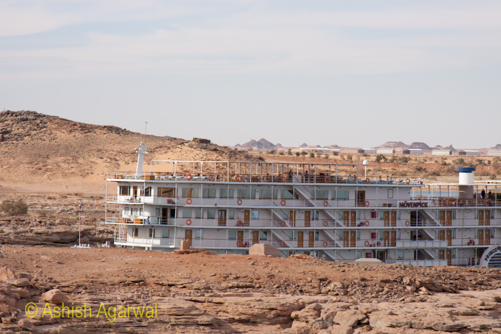 Cruise ship coming in to the Abu Simbel temple in south Egypt over the water