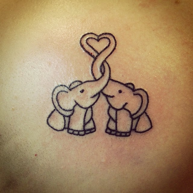 10 cute elephant tattoos designs catanicegirl. Black Bedroom Furniture Sets. Home Design Ideas