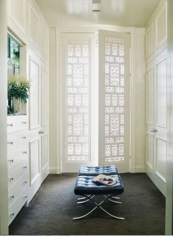 White walk in closet fretwork doors barcelona stools glossy paint