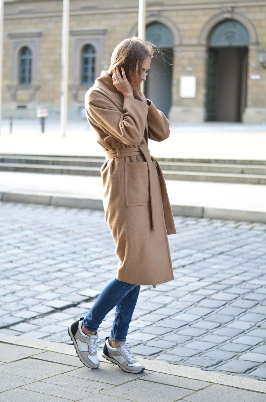 kristjaana mere minimalist camel coat outfit with sneakers