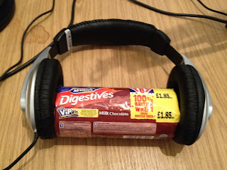 packet of chocolate digestive biscuits wearing headphones