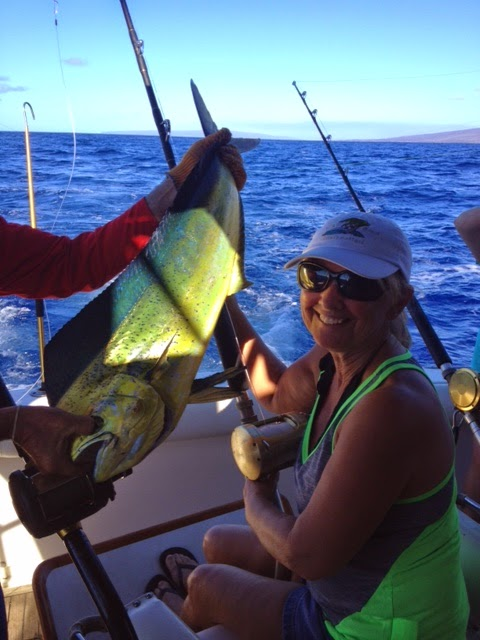 LuAnn catches a Mahi Mahi while sport fishing last week!