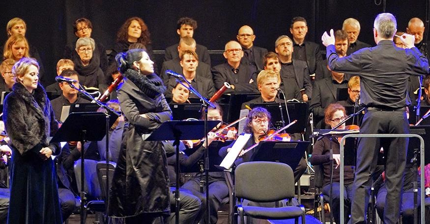 Soprano Ilse Eerens (left), VIVICA GENAUX (center), and conductor David Angus (right) in performance in Leuven's WWI commemoration, 24 August 2014 [Photo © 2014 by Albertine Eylenbosch; used with permission]