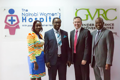 Alberta Wambua, John Kipchumbah, Jim Fruchterman and Dr. Sam Thenya in front of hospital signs