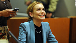 Lindsay Lohan beaming at a previous court appearance.