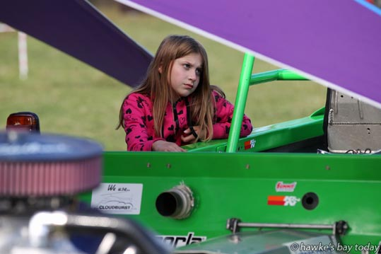 Millie Simmons, 9, Patoka, waiting for her Dad, David Simmons, Patoka - Meeanee Speedway Swapmeet, Hot Rod and Classic Car Display, Marineland Street Rods - at Meeanee Speedway, Meeanee, Napier photograph