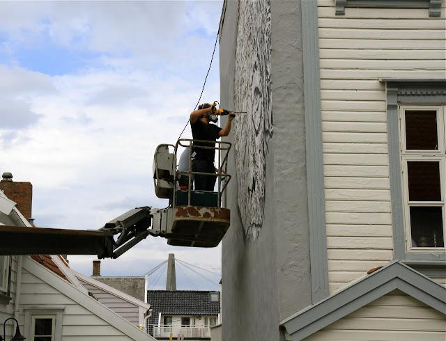 street artist vhils at work for nuart 2013 2