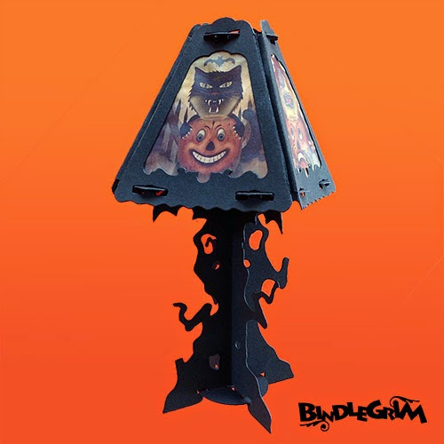 The newest Spooklight Halloween decoration features a haunted tree lamp base that pairs with a four-sided lantern shade.