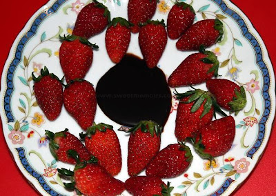 photo of strawberry dipped in chocolate fondue