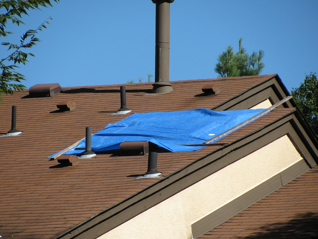 Two Homes In The Community Have Blue Tarps Covering The Skylights On Their  Roofs. The Tarps, Which Are Plainly Visible From The Loop Road, Have Been  Up For ...