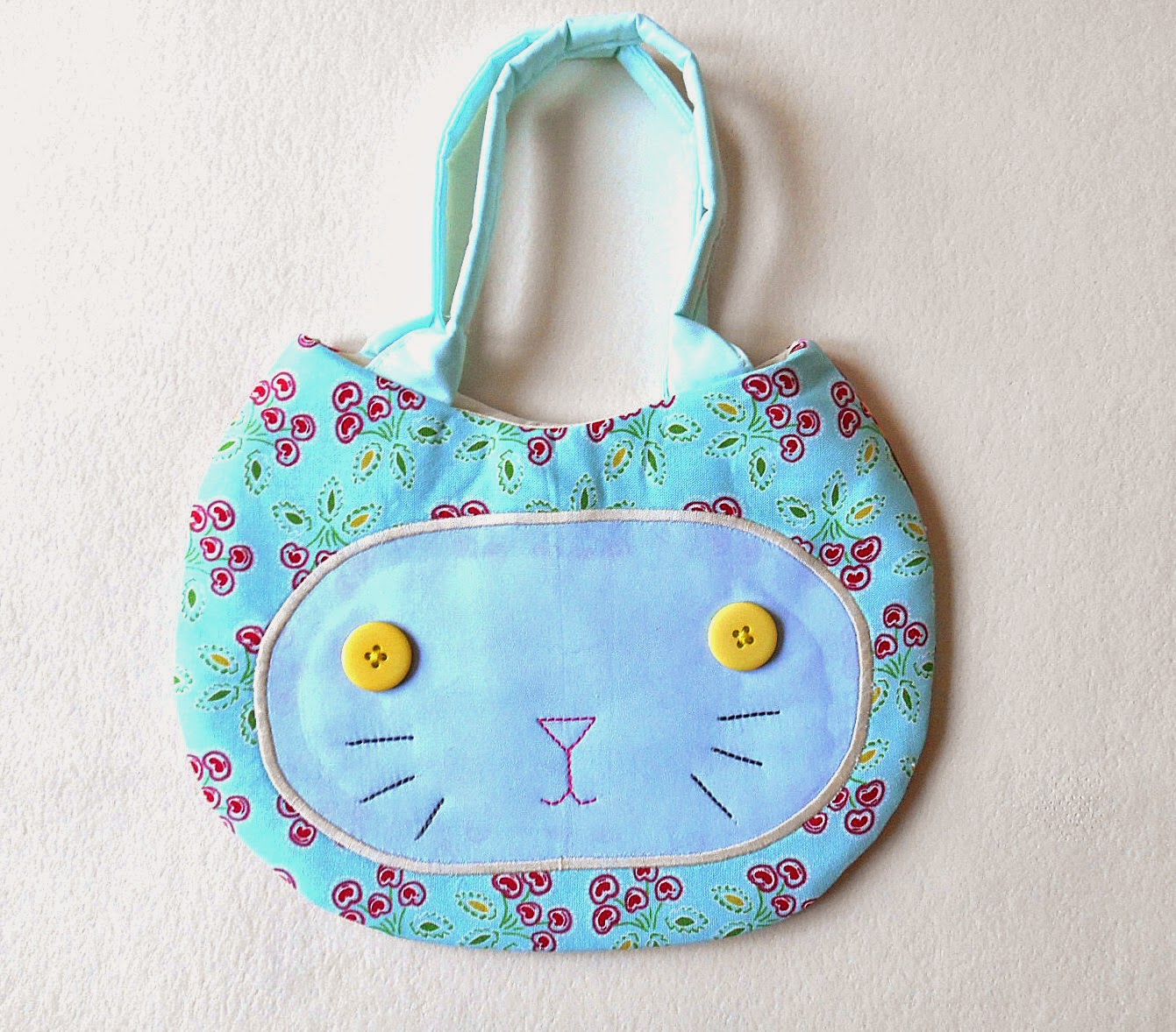 aqua kitten face purse