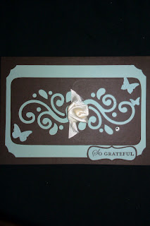 negative of scribbles die, butterfly embosslits, vanilla satin ribbon