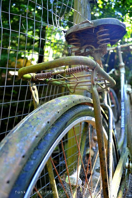 A junk themed campsite... a photographer's dream! via Funky Junk Interiors / rusty bikes