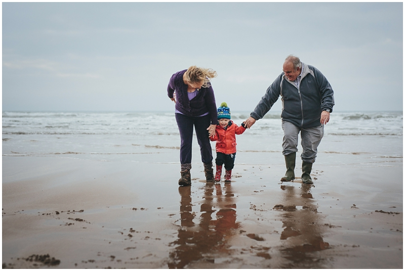 Grandparents with grandson on the beach