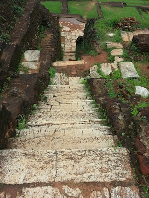 Ancient ladder, white marble, leads down from Sigiriya summit, Pyramid top, granite stone throne, carved rock