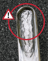 eroded glass in liquid level gages