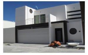 Fachadas de casas modernas diciembre 2011 for Cocheras minimalistas