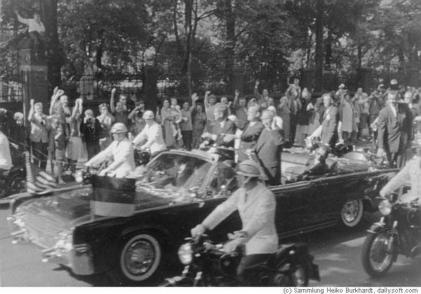 AGENTS ON REAR OF LIMO, MOTORCYCLES BESIDE CAR- JUNE 1963