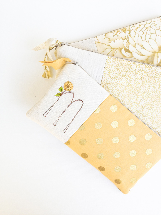 Gold monogram wedding clutches | bridesmaid gifts