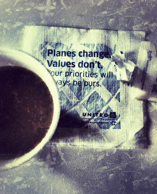 United Airlines napkin and coffee photo edited in Snapseed