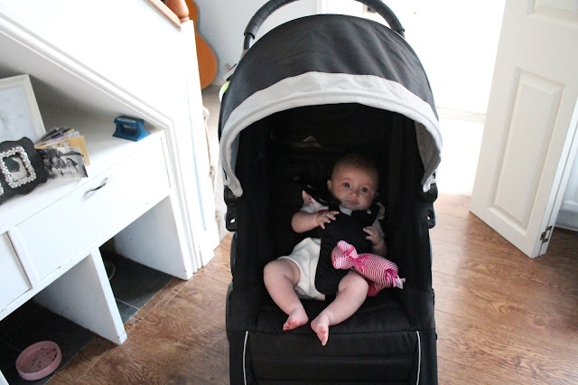baby in city mini jogger pushchair