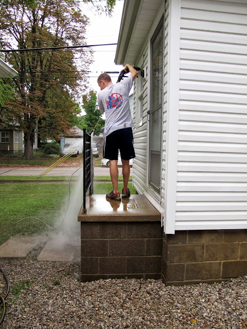 Brian Power-Washing the House