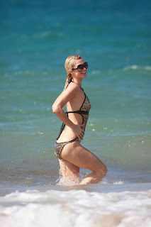 Paris Hilton having fun in a classic bikini with her boy friend in beach.