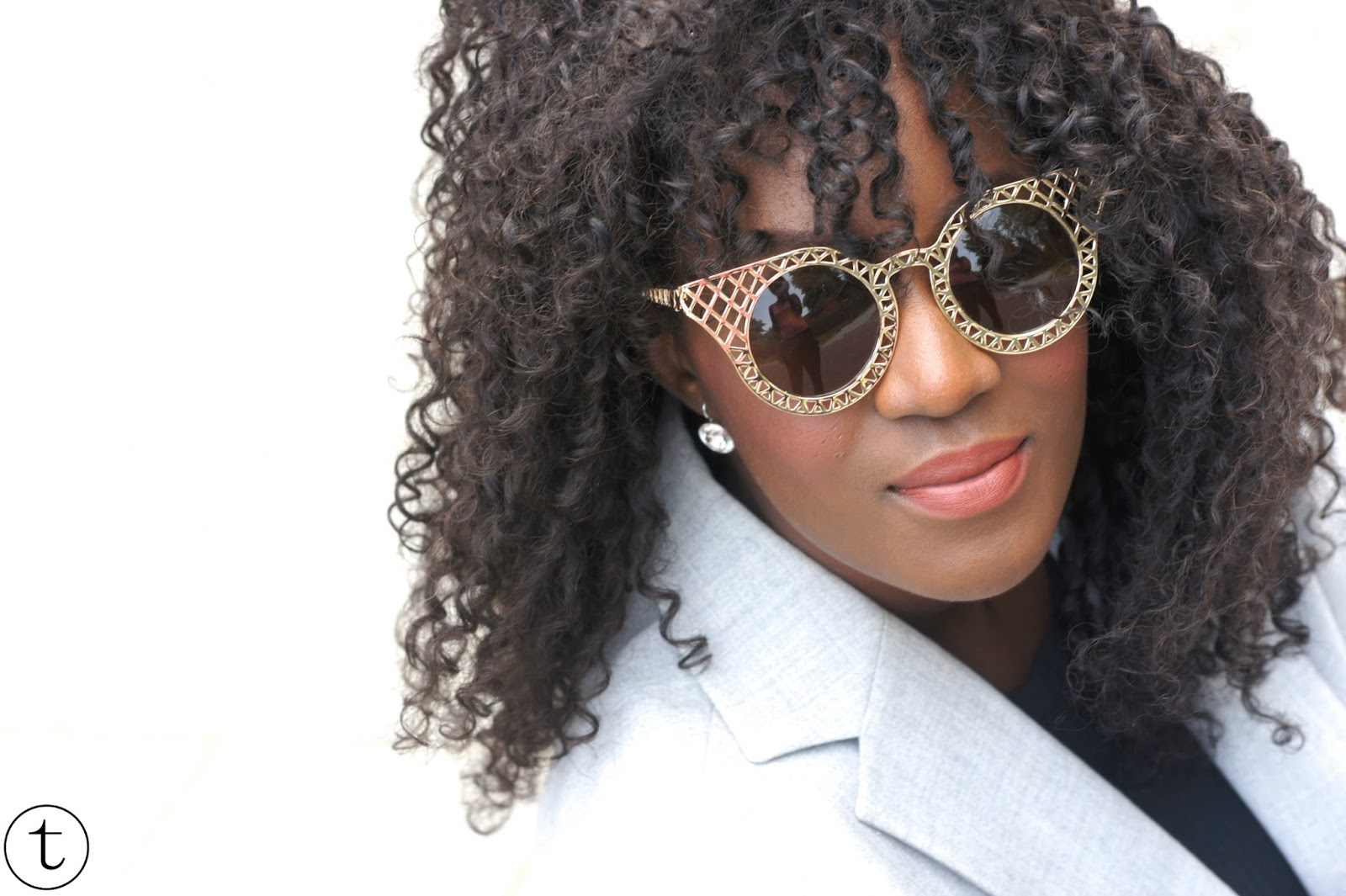 outfit post wearing golden sunglasses from polette