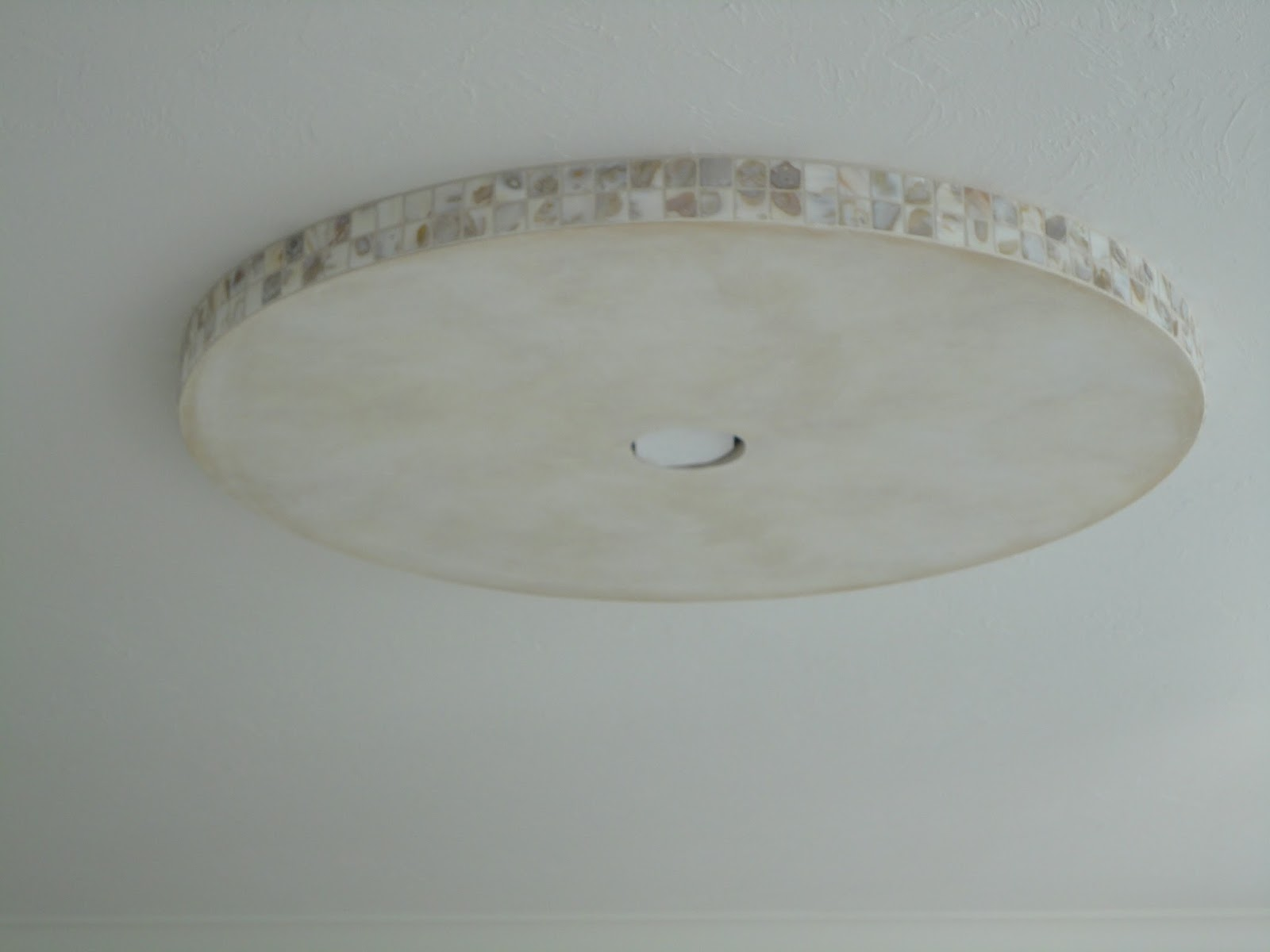 Tile sarasota sarasota tile contractor van osdol marble and tile sarasota tile contractor van osdol marble and tile here is a mosaic shell tile that we installed around a ceiling fan platform the tile matches the tile dailygadgetfo Gallery
