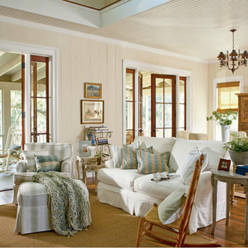 coastal white slipcover sofas with light blue throw pillows