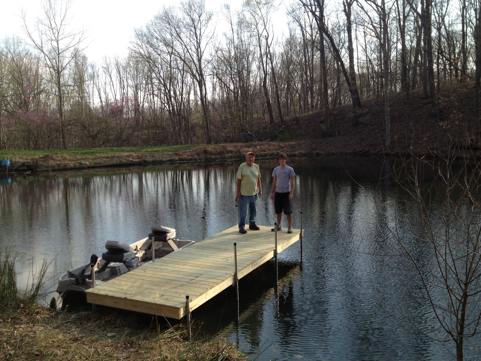 Scott cohen designs and builds these faux wood concrete for Small pond construction