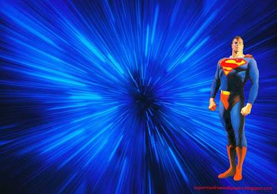 Desktop Wallpaper of Superman Standing Tall in Blue Vortex