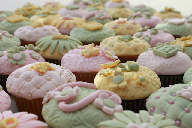 http://cupcations.blogspot.com.au/2011/09/pale-green-yellow-and-pink-baby-shower.html