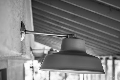 closeup of the outdoor light on a covered deck