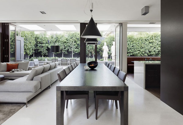 Photo of modern dark brown dining table in the dining room