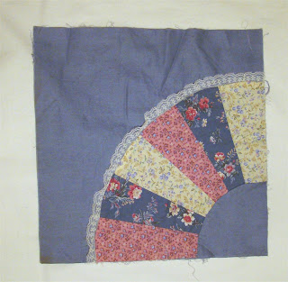 six-panel fan appliqued on blue background square