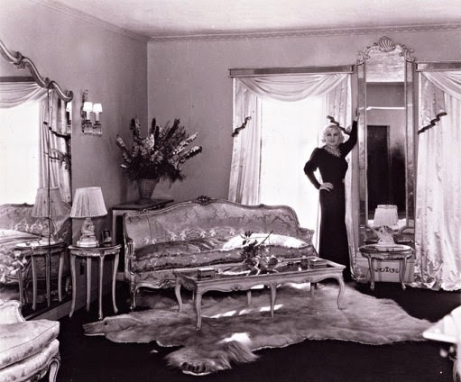 Mae West in her living room.