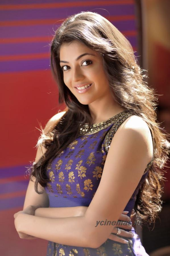 Kajal Agarwal posing in a blue dress with gold embroidery - Kajal Agarwal Blue Dress Photos