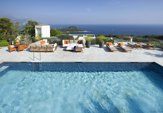 Large swimming pool with the terrace looking on the sea