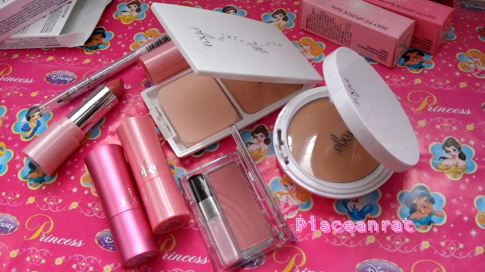 pixy makeup, eye pencil, blush, powder, foundation
