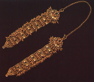 Jhela with chain, Jaipur  The gold jhela head ornament—has been carefully crafted to drape over the head and fall to either side of the face, ending in earrings which would have been fixed to the lower ends.