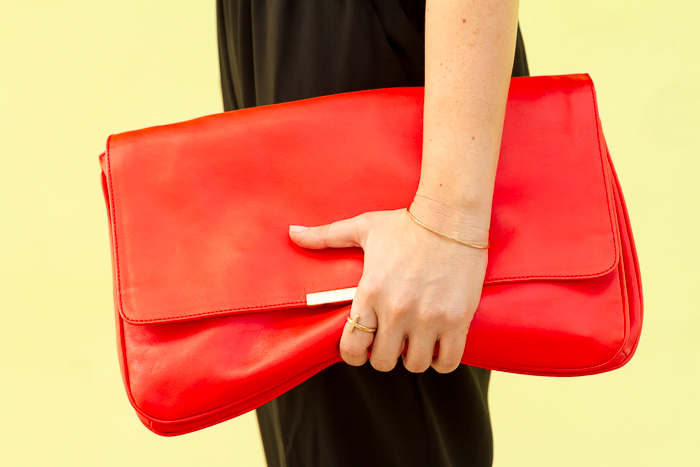 Lumo golden bracelet and red leather clutch