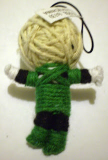 Back of vending machine mini Green Lantern string puppet