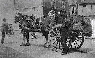 Vintage horse and coal cart